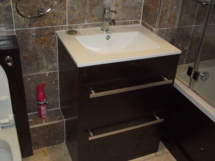 Large (600mm) inset basin mounted on 'wenge' effect double drawer vanity unit.  http://www.ppmsltd.co.uk