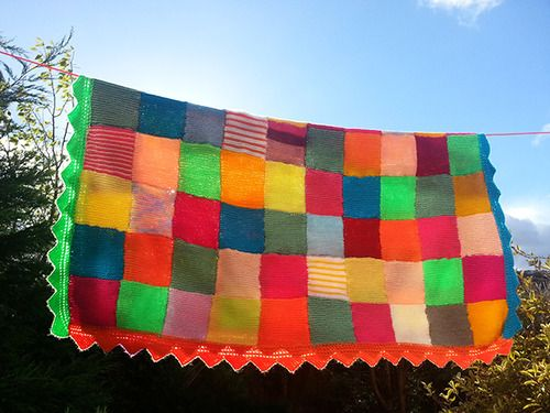 Here it is my hand knitted patchwork blanket, with decorative edging finally finished!