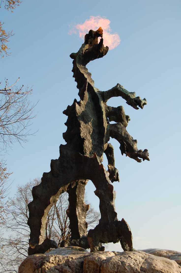 Dragon of Wawel Hill,  a metal sculpture  designed by Bronisław Chromy, placed in front of the dragon's den.