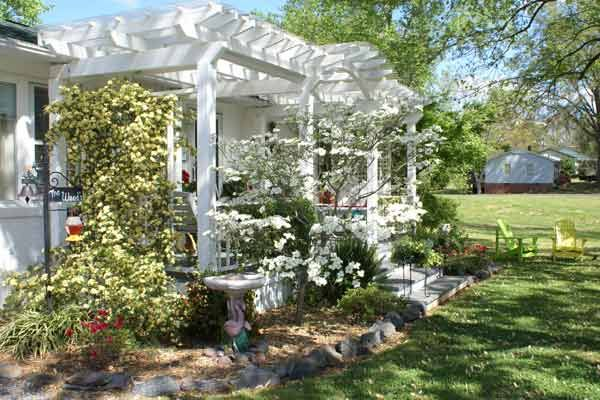 """Who: Carla W.Where: Gastonia, NC""""The rails across the front were powder-coated white so that we wouldn't have to repaint after the jasmine grew. Now we love relaxing on our porch every day, every season.""""Who did the work: """"We did all the work ourselves.""""Cost: $1,000 to $5,000See all the images from this entry."""