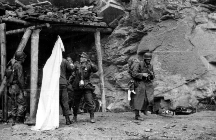 Cherbourg June the 26th 1944, 14:00. German soldiers emerge from the command post of General von Schlieben under the white flag.