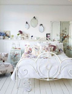 I love how peaceful this bedroom is. The modesty panel is particularly beautiful with a stunning peacock design
