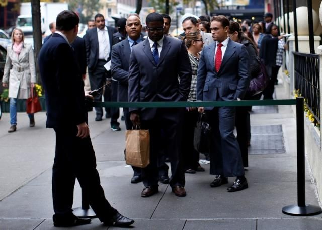 U.S. jobless claims near 42-year low as labor market tightens  -- Job seekers stand in line to meet with prospective employers at a career fair in New York City, October 24, 2012. / Dec 24 '15