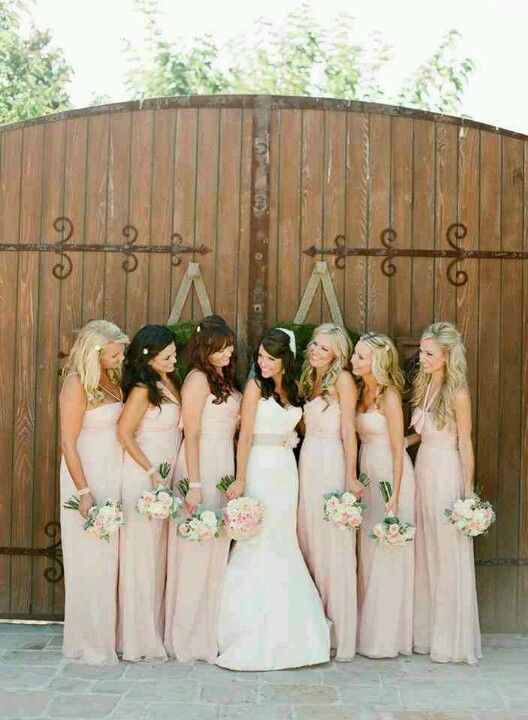 Blush bridesmaids -- long dresses are less formal when they have more of a light, deconstructed look.