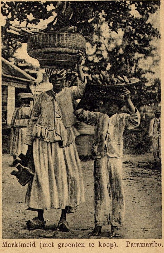 Surinam Paramaribo market maid 1901 notice the Dutch wooden shoes.