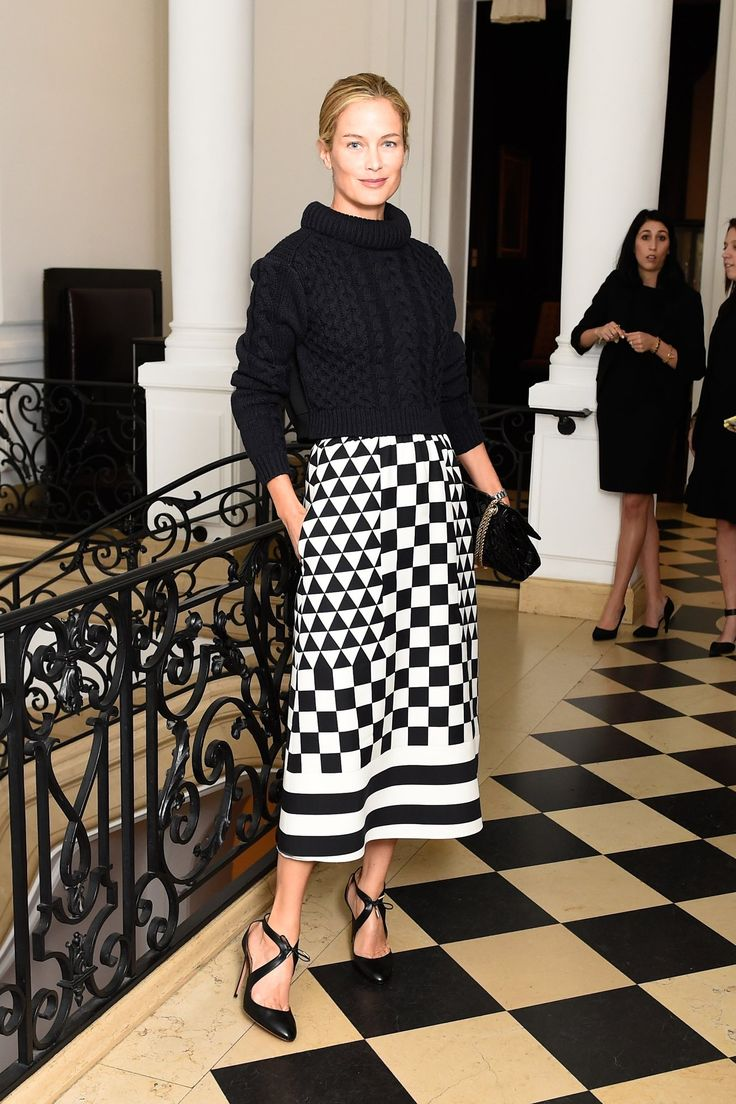 Carolyn Murphy in a graphic midi skirt + black turtleneck sweater.