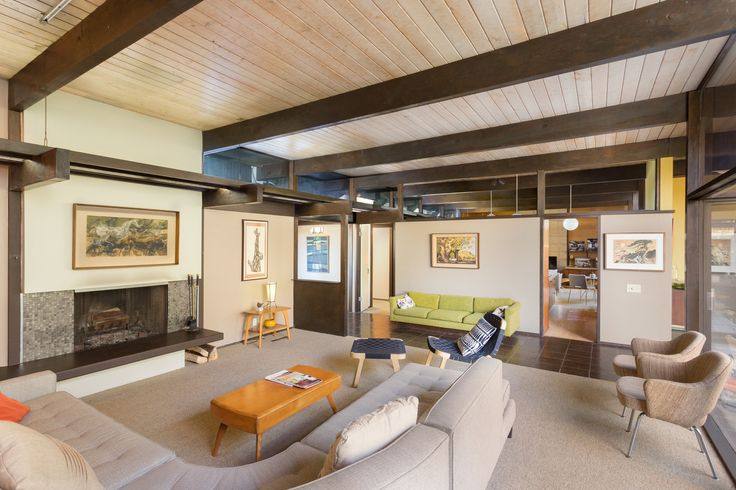 The fireplace in the living room provides a cozy setting for relaxing or entertaining. According to Matthew Berkley at Crosby Doe Associates, the design elements of the home recall the work of architects who had studied at USC—such as Fred McDowell.