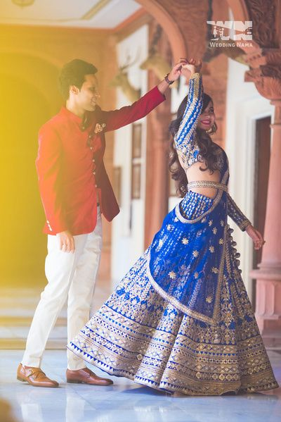 royal blue lehenga , blue bridal lehenga , blue sangeet lehenga , gota patti lehenga , blue and gold lehenga , waist belt , embroidered waist belt , engagement lehenga , full sleeves blouse , bride and groom coordinated outfits , silk lehenga