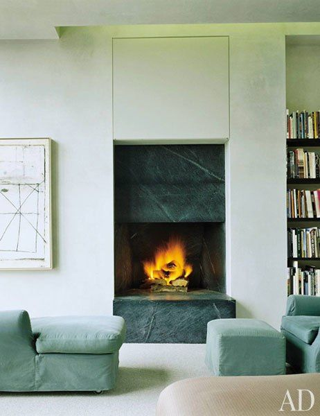 For a home outside Santa Fe, New Mexico, architect Stephen Bucchieri took design cues from nature, crafting a modern house in harmony with the surrounding landscape. A soapstone fireplace and plush seating create a cozy lounge area in the master bedroom. (October 2006)