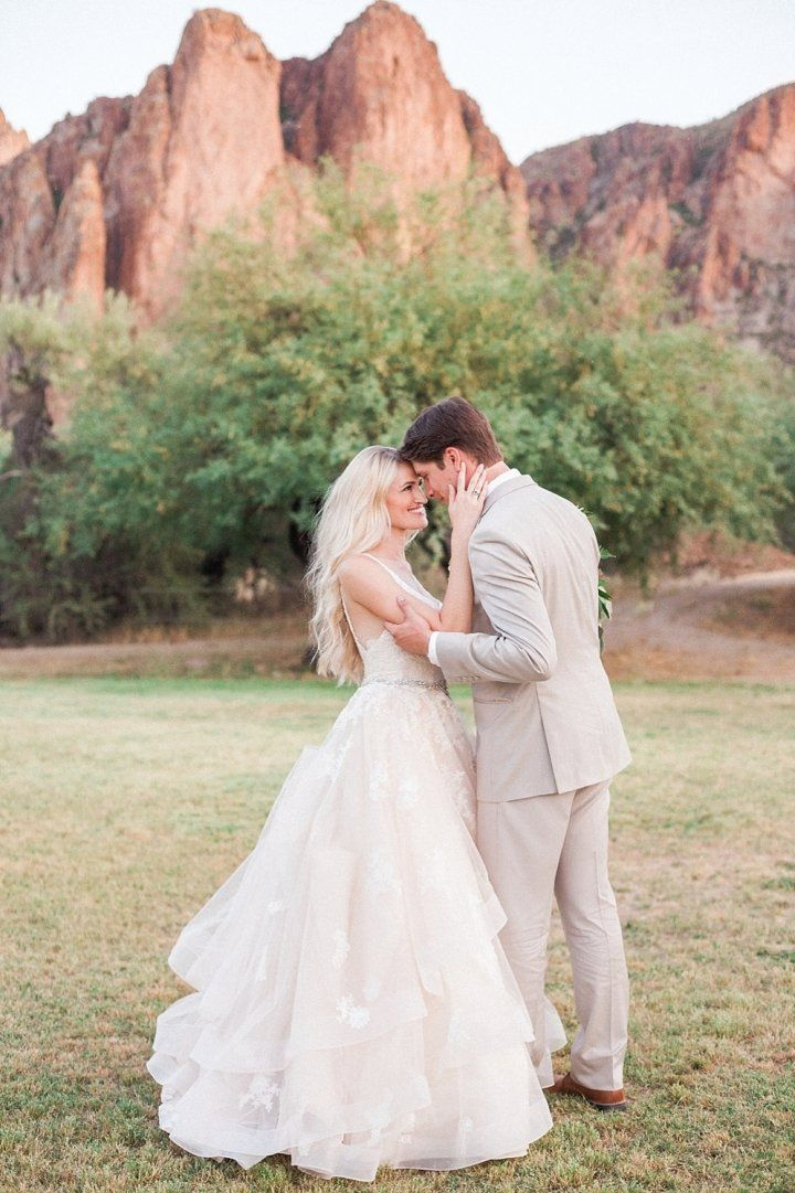 We can't get enough of McKenzie and Tyler's glamorous rose gold desert mountain wedding! Metallic bridesmaid dresses, sequin table runners, succulent center