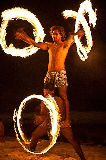 Fire dancers on the beach. Aitutaki, Cook Islands