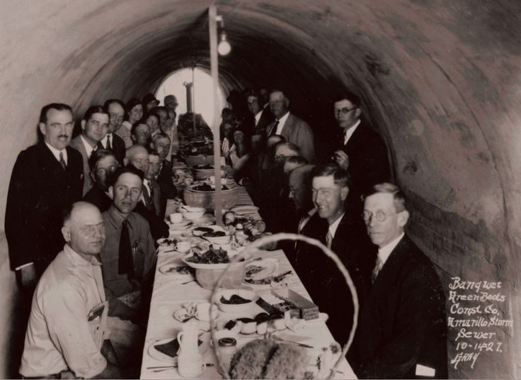 Engineering firm eating dinner in a storm drain pipe. Amarillo TX 1927