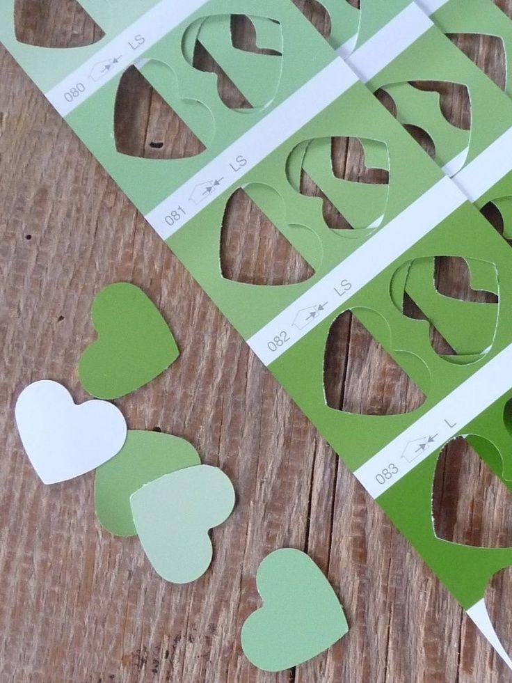 Herzen in allen Farben: Einfach ein paar alte Farbmusterkarten mit einem Herzchen-Locher ausstanzen. Perfekt für den Valentinstag! www.madowl.de