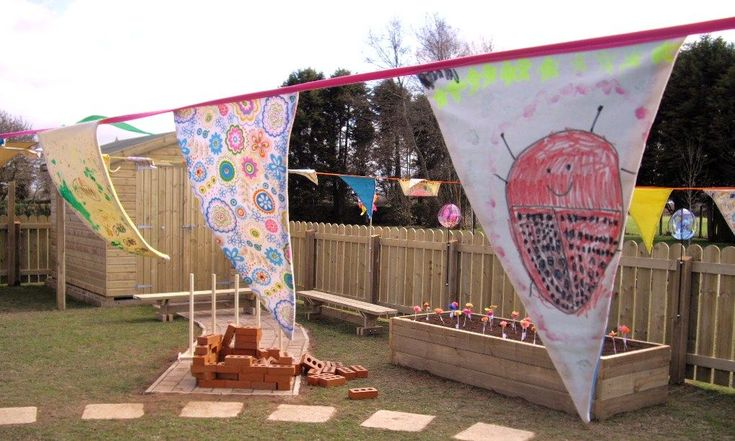 Threemilestone School, Childrens artwork on Celebration Bunting. The reception class created their beautiful garden themed designs on canvas with fabric pens, which i turned in to bunting