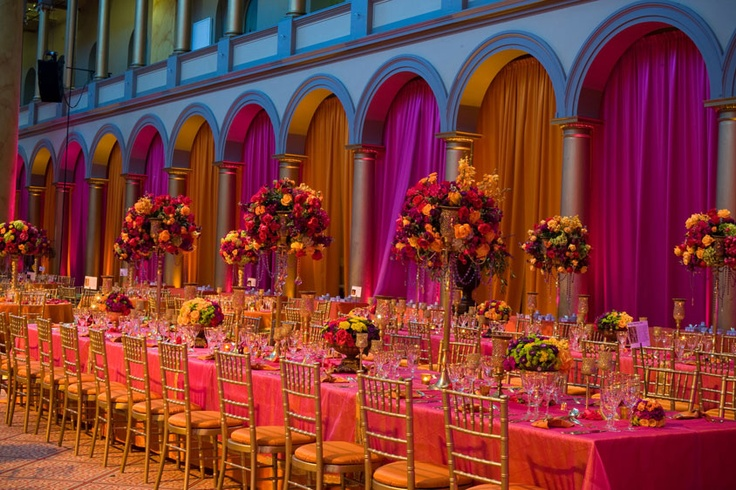 Love the tall, bright bold color, floral centerpieces