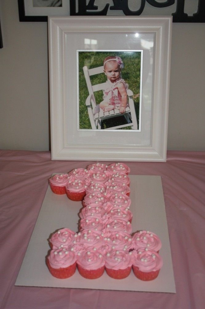 Girl1st birthday cake made out of cupcakes.