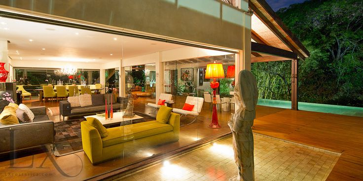 Amazing view of the living room from the outside at Casa Essentia  http://lxcostarica.com/property/casa-essentia-villa-real Santa Ana, Costa Rica
