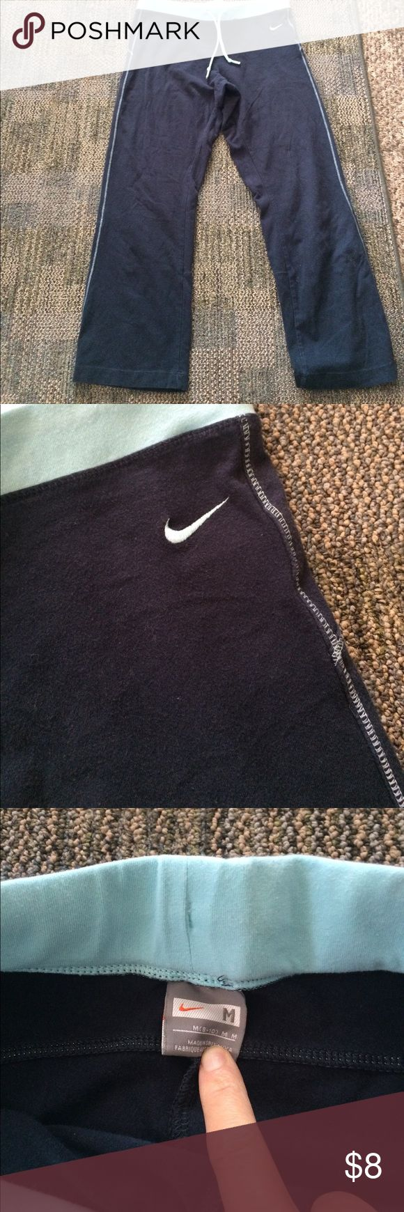 Nike Capri Really cute navy blue and light blue Nike Capri size m 92% cotton super comfortable in good used shape they do show slight wear from washing but still real nice Nike Shorts