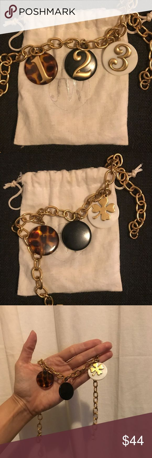 john wind 1-2-3 lucky clover necklace john wind 1-2-3 lucky clover necklace. beautiful gold chain with different colored charms —black, white, tortoise. #3 has a lucky clover on the back. you can flip and wear the charms any way you want! john wind Jewelry Necklaces