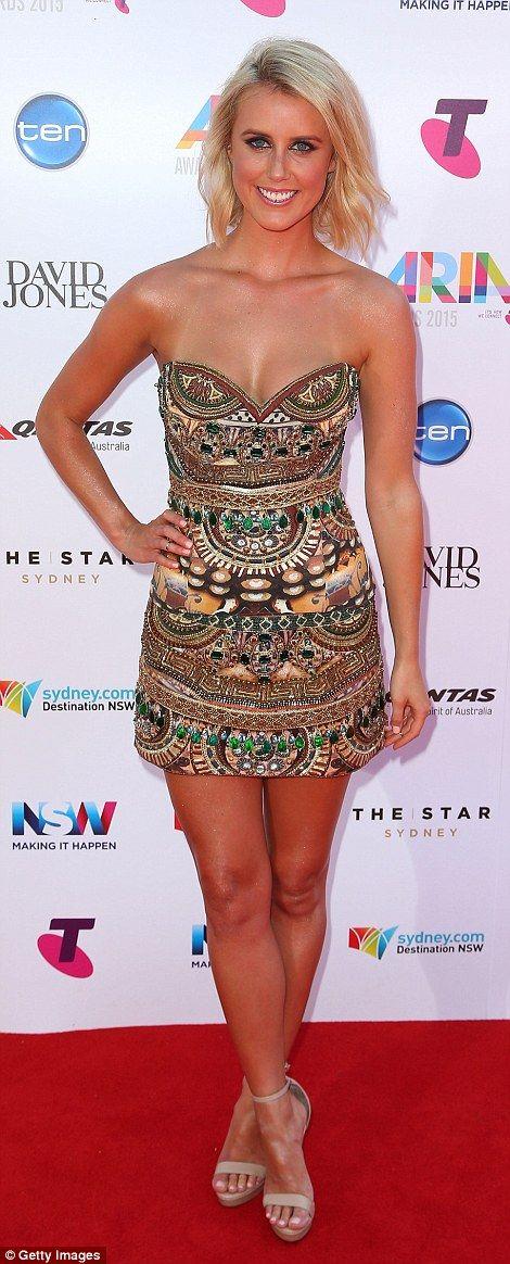 Golden girls: Olivia Phyland donned a strapless multi-print mini dress