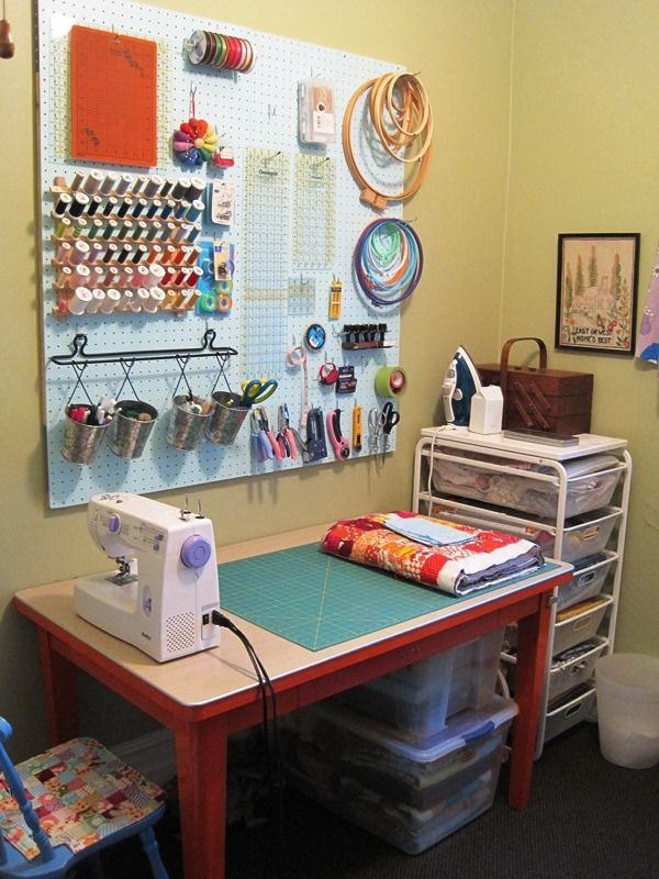 super cute small space sewing room - machine should be at the other end to be useable though, LOVE the peg board