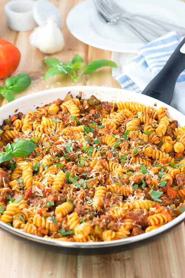 Italian Sausage and Peppers Pasta Skillet - All you need is 6 simple ingredients for this comforting and delicious skillet meal!   www.deliciousmeetshealthy.com