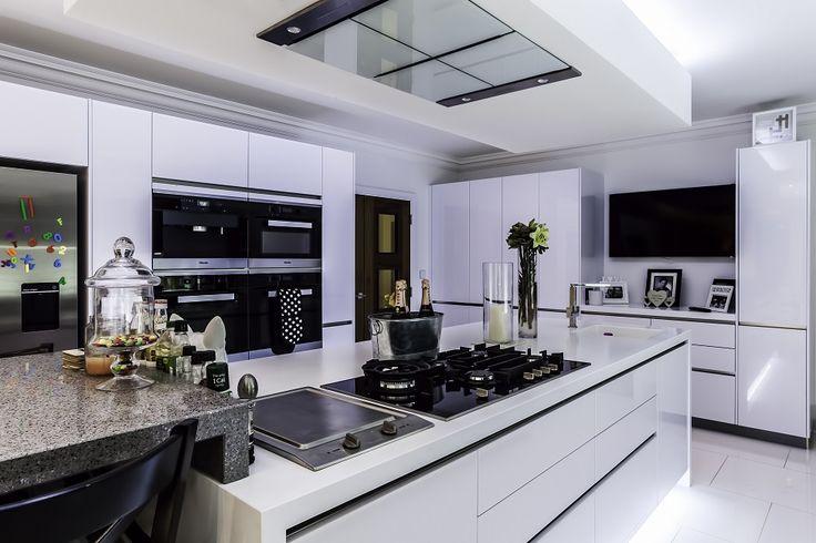 High Gloss Polar White Doors with Miele Appliances, Glacier White Corian and Chrom Silestone  - Hutton Kitchens