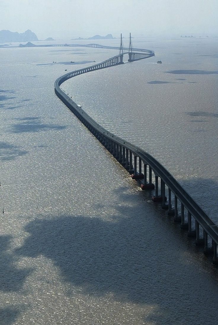 Donghai Bridge: It has a total length of 32.5 kilometres (20.2 mi) and connects mainland Shanghai's Pudong New Area with the offshore Yangshan Deep-Water Port in Zhejiang's Shengsi County. [http://en.wikipedia.org/wiki/Donghai_Bridge]