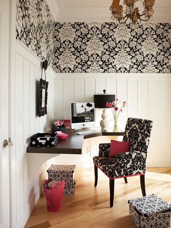 Lovely chic black and white home office with pink accents + wall mounted corner desk for a streamlined effect. | bhg.com