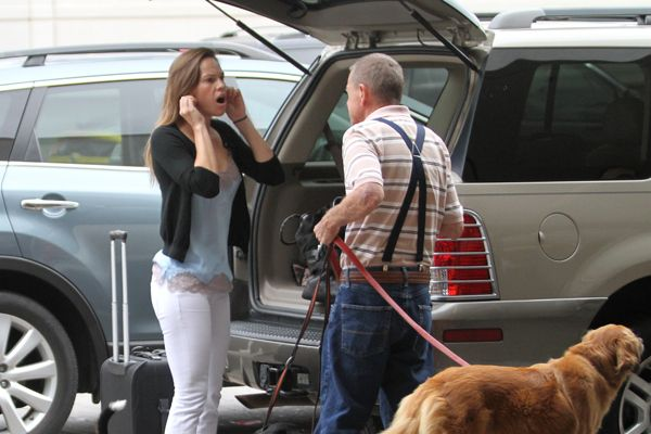 Hilary Swank Arrives at LAX with 2 Alive Carry On's...Her 2 Dogs...Do They Get A Drink and Complementary Peanuts Too?