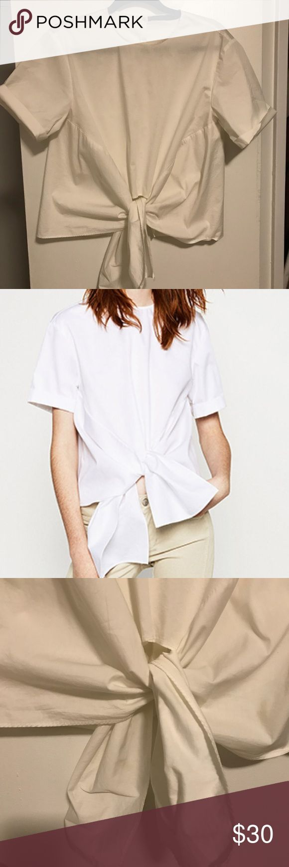 ZARA knot front button down back blouse Cotton & nylon white blouse with knot bottom front, button up back, and rolled up cuffs on arms. Worn once Zara Tops Blouses