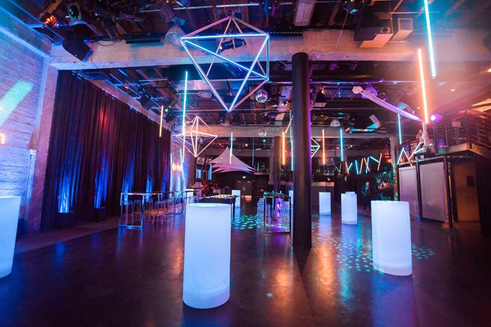 """<p> To match the futuristic theme, Got Light brought in their """"Trondeliers,"""" or illuminated geometric fixtures. When event planner Caryl..."""