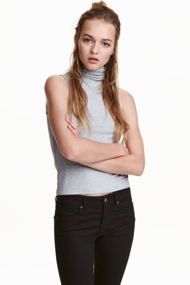 Sleeveless polo-neck top: Sleeveless top in ribbed jersey with a polo neck.