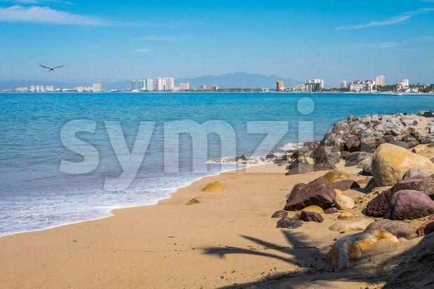 Stock photo of Beach Puerto Vallarta from $1.99. Rocky beach at Malecon boardwalk, Puerto Vallarta, Jalisco, Mexico. View...