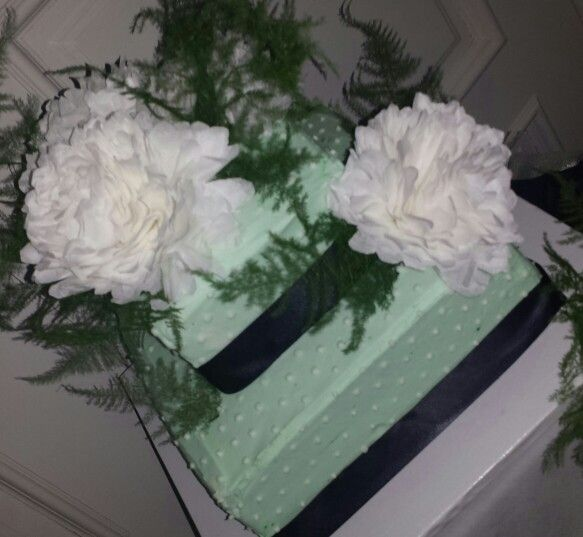 Mint green navy wedding cake with coffee filter flowers