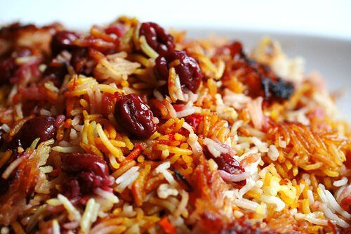"""Luscious sour cherries....saffron....basmati rice....if there ever was a rice dish that could tease me into submission, this would be it. When I lived in Hollywood, I used to frequent a Persian restaurant and order just a big ginormous platter of cherry saffron rice with two 16"""" spears of hunky shish kababs. A dish designed for two, consumed by one, me.By the way that I talk about food, you'd think I have an eating disorder addiction obsession. When presented with a food that ..."""