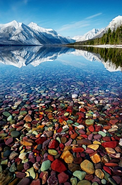 As if Lake McDonald in Montana's Glacier National Park wasn't spectacular enough, beneath the crystal clear waters of the south western shore, you'll find these amazing beach of coloured pebbles.   The stones, formed from all the different minerals of the surrounding mountains, are polished smooth as they make they're way down to the lake bed, resulting in this pretty incredible shoreline.
