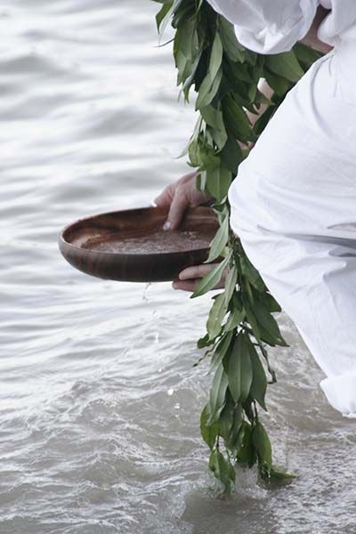 "Ring Blessing Ceremony    Koa wood bowls are dipped into water and filled for the ring blessing ceremony. Koa wood is a treasured hardwood that represents integrity and strength in Hawaii. A Ti leaf (representing prosperity, health and blessings) is dipped into the koa bowl and then held over the wedding rings to drip water on them. This is done three times while the following blessing is recited:  ""Ei-Ah Eha-No. Ka Malohina Oh-Na-Lani. Mea A-Ku A-Pau.""  Translation: ""May peace from above…"