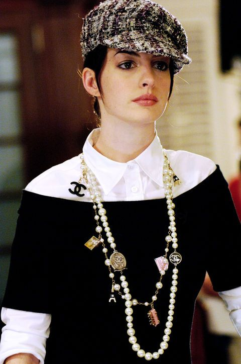 Anne Hathaway's Transformation in The Devil Wears Prada Was So Good! Number 3: While I'm not (and most likely never will be) a huge fan of newsboy caps, I died for Andy's two-strand Chanel necklace and appreciated her layered sweater and crisp white button-down styling: