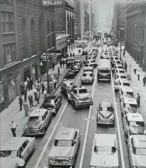 Taxi drivers line Adams Street at LaSalle in support for a controversial new union leader, 1959, Chicago. Notice the city has begun to ticket and tow the protesting drivers. via theoldmotor.com
