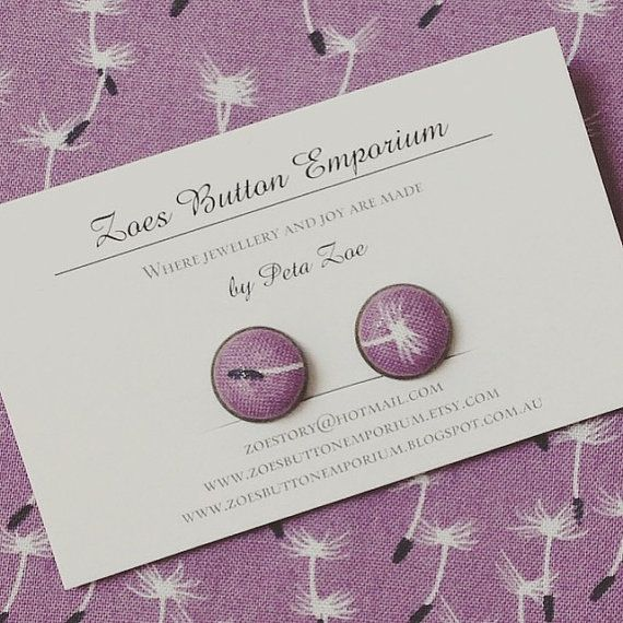 Mauve fabric covered button earrings (small clip-on style), featuring images of dandilion fluff. 1 pair for $9.00 by www.zoesbuttonemporium.etsy.com and available at the #etsymadelocal Markets, Canberra.