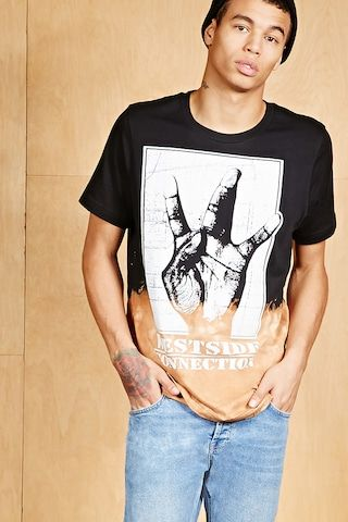"""A knit tee featuring a """"Westside Connection"""" graphic, tie-dye design, crew neck, and short sleeves."""
