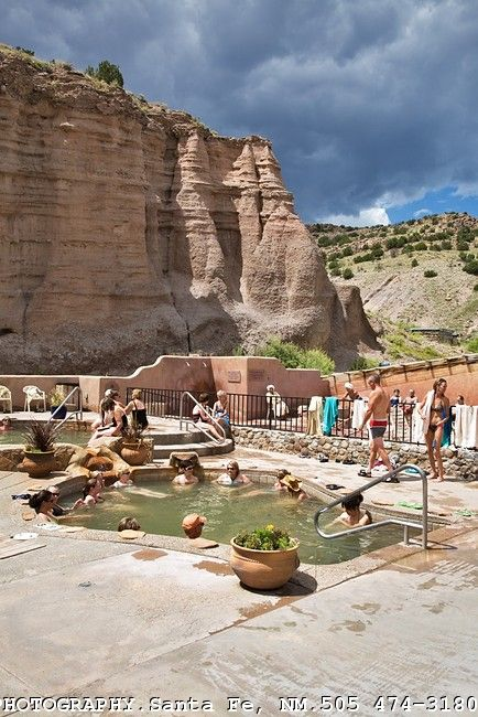 Ojo Caliente Mineral Springs, New Mexico.  The resort and hot springs are open year round.  It's especially wonderful on sunny winter days when snow is all around as you lounge in the hot pools.