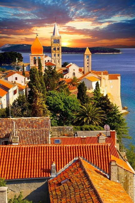 View from St John Church tower over the medieval roof tops of Rab town . Rab Island, Croatia