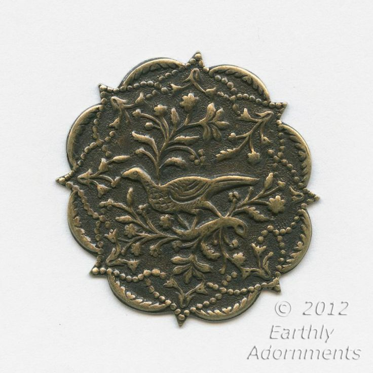 Superb oxidized stamped brass plaque.  Punch a hole and you've got a pendant.  Wonderful pheasant and foliage design with a Persian flavor.  40mm diameter.  Sold individually