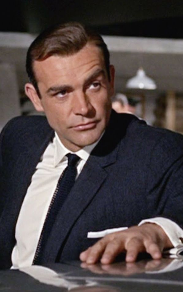 Sean Connery as James Bond  - Goldfinger (1965)