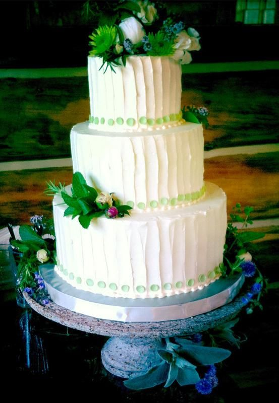 Rustic white cake with green pearls and herbal accents