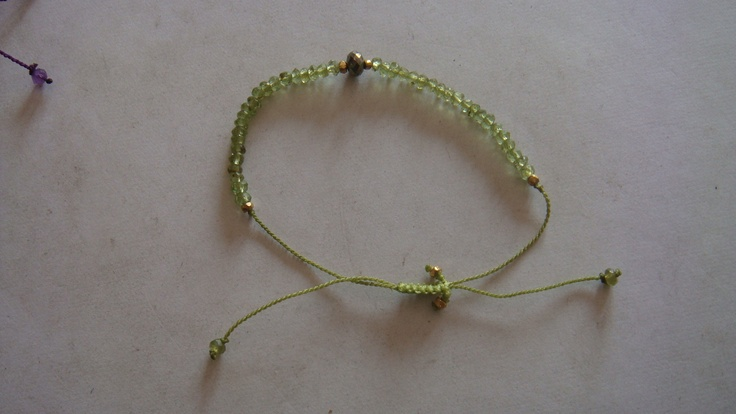 Braslet made with Peridot and pyrite beads,cost 6 $ per pc