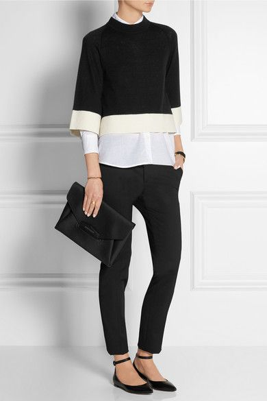 Victoria, Victoria Beckham (sweater). Equipment (shirt). Gianvito Rossi (flats). Givenchy (clutch).