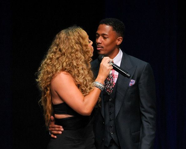 Mariah Carey Photos - Mariah Carey (L) and Nick Cannon kiss at the 12th Annual BMI Urban Awards at Saban Theatre on September 7, 2012 in Beverly Hills, California. - 12th Annual BMI Urban Awards - Show